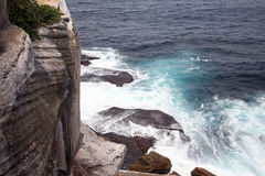 Cliff near the sea. With rocks and waves Royalty Free Stock Photo