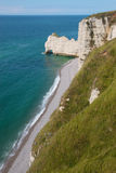 Cliff in Normandy France. Top view of a cliff in Etretat, France in Normandy with its pebble beach royalty free stock images