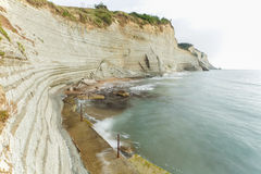 Cliff at northwest coast of Corfu, Greece. Logas beach at Peroulades village at Corfu island, Greece Stock Photography
