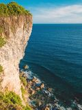 Cliff and ocean with waves, rocks in Bali. Cliff and ocean with waves, rocks Stock Images
