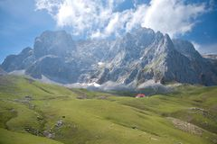 Cliff over cottage in Cantabrian mountains Stock Image