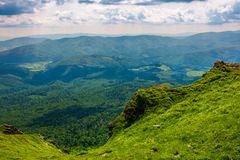 Cliff over the hill in high mountains. Beautiful summer landscape and travel concept Royalty Free Stock Image
