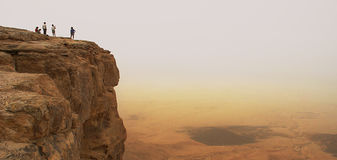 Cliff over the Ramon crater (panorama). Panoramic view on cliff over the Ramon Crater in Negev Desert in Israel Royalty Free Stock Image