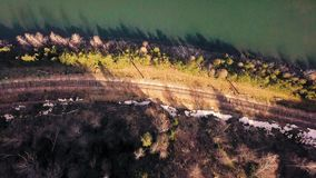 Cliff over the river. Shot of a cliff and a river from above with a drone stock video footage
