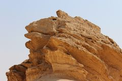 A cliff peak in the desert. A cliff peak in the shape of a frog head in the Israeli desert Stock Photo