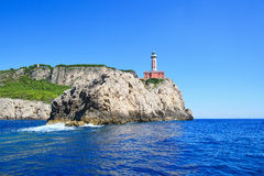 Cliff Punto Carena with lighthouse on coast of Tyrrhenian sea, C Stock Photos