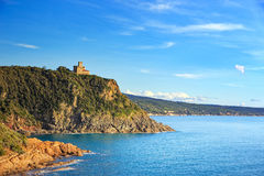 Cliff rock and building on the sea on sunset. Quercianella, Tusc. Any riviera, Italy, Europe stock photography