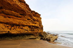Cliff and rock formations at a beach Royalty Free Stock Images