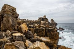 Cliff Rocks, Foggy Landscape of Portugal. Rocky ocean shore. Cliff Rocks, Foggy Landscape of Portugal. Vintage Wallpaper, Rocky ocean shore Royalty Free Stock Photos
