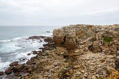 Cliff Rocks, Foggy Landscape of Portugal. Rocky ocean shore. Cliff Rocks, Foggy Landscape of Portugal. Vintage Wallpaper, Rocky ocean shore Stock Photos