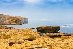 Cliff near Azure Window in Gozo, Malta. Cliff and rocks near Azure Window in Gozo, Malta Stock Images