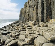 Cliff and rocks by ocean Stock Photo