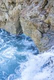 Cliff, Rocks by the sea with waves of the Mediterranean sea next. To the Cabo de Formentor in the Balearic Islands, Spain. Scenes of Spanish tourism Royalty Free Stock Photography