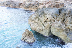 Cliff, Rocks by the sea with waves of the Mediterranean sea next. To the Cabo de Formentor in the Balearic Islands, Spain. Scenes of Spanish tourism Royalty Free Stock Image