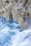 Cliff, Rocks by the sea with waves of the Mediterranean sea next. To the Cabo de Formentor in the Balearic Islands, Spain. Scenes of Spanish tourism Royalty Free Stock Photo