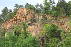 Cliff. Rocky Cliff in a Quarry Stock Image
