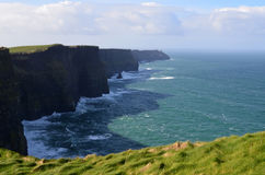Cliff`s Of Moher Casting a Shadow on the Ocean Below Stock Images