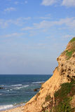 Cliff and sea. Rock cliff formation and mediterranean sea, Israel Royalty Free Stock Photography
