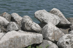 Cliff on the sea. Big rocks form a cliff on the sea Royalty Free Stock Photo