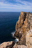 Cliff with sea, horizon and sky in the back. In the Sardinian coast Royalty Free Stock Image