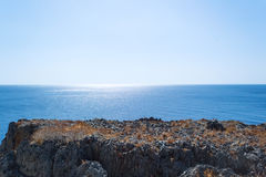 Cliff in the sea Stock Images