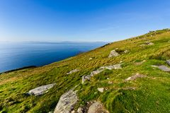 cliff by sea under blue sky , Ireland Royalty Free Stock Images