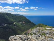 Cliff and the sea. View of the mountains and the Atlantic at Cape Breton in Nova Scotia Stock Image