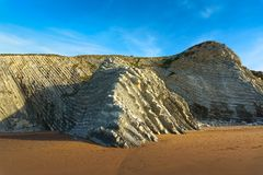Cliff of sedimentary rocks named flysch in Sopelana. Beach stock images