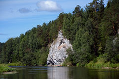 Cliff `Sentry Rock` on the shore of Chusovaya river. Stock Images