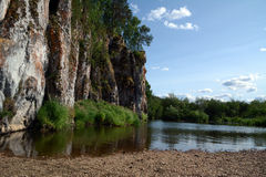 Cliff `Shaitan Rock` on the shore of Chusovaya river. Cliff `Shaitan Rock` on the shore of Chusovaya river, Sverdlovsk Region, Russia Stock Photo
