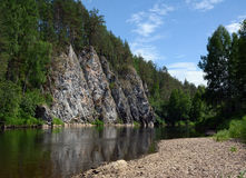 Cliff `Siberian Rock` on the shore of Chusovaya river. Cliff `Siberian Rock` on the shore of Chusovaya river, Sverdlovsk Region, Russia Royalty Free Stock Images