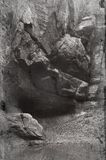 Cliff side. Black and White image of a base of a cliff. Vintage glass plate look Stock Images