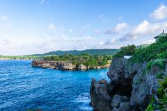 Cliff side/cliffside coastline view on tropical Caribbean island ocean. royalty free stock images