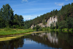 Cliff `St. George Rock` on the shore of Chusovaya river. Cliff `St. George Rock` on the shore of Chusovaya river, Sverdlovsk Region, Russia Royalty Free Stock Images