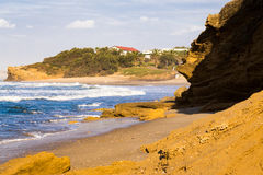 Cliff stone beach village sea waves, beautiful nature landscape. Royalty Free Stock Image