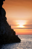 Cliff Strombolicchio, sunset, Italy Royalty Free Stock Photo