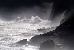 Cliff surf. Stormy seas crash against Cape Town cliffs Royalty Free Stock Images