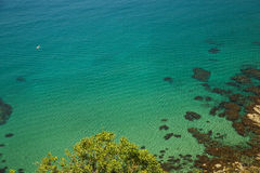 Cliff to the sea with crystal clear water Royalty Free Stock Images