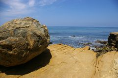 Cliff-top boulder. A cliff-top boulder over looking the pacific ocean Royalty Free Stock Photo