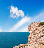 Cliff under clouds Stock Photo