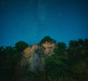 Cliff under star night sky Stock Image