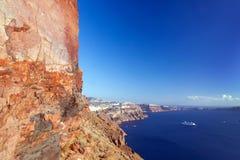 Cliff and volcanic rocks of Santorini island, Greece. View on Caldera. And Aegean sea, sunny day, blue sky Stock Image
