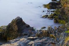 Cliff Walk in Rhode Island. Ocean Waves Over Rocks at Cliff Walk in Rhode Island Stock Photos