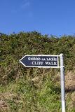 Cliff walk sign beside the cliffs. In Ballybunion county Kerry Ireland in English and Gaelic Royalty Free Stock Photo