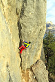 Cliffhanger. Rock climber to climb the wall Royalty Free Stock Image