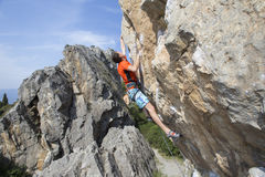 Cliffhanger. Rock climber to climb the wall Stock Images