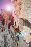 Cliffhanger. Rock climber to climb the wall Royalty Free Stock Images