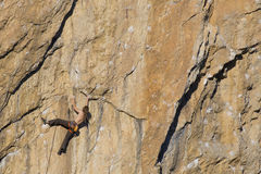 Cliffhanger. Rock climber to climb the wall Stock Photography
