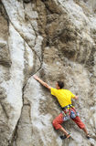 Cliffhanger. Young male climber hanging by a cliff Stock Photos