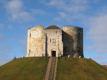 Clifford's Tower. Cliffords tower in York, England. One of the most popular tourist attractions in this historic city, Cliffords tower is instantly recogniseable Stock Photography